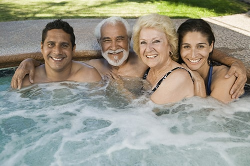Family Smiling in Hot Tub